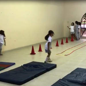 Practicing coordination, skills and  body agility with the primary students.